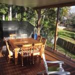 Merbau deck, aluminium screen, glass rails & an insulated colorbond roof